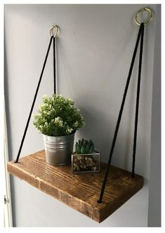 Check out the tutorial how to make DIY hanging rope shelving DIY Home Decor Idea Hanging Rope Shelves, Plant Shelves, Rustic Wooden Shelves, Wood Shelves, Hanging Furniture, Diy Furniture, Diy Bedroom Decor, Diy Home Decor, Decoration Photo