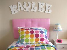 Easy headboard for Bryelle's new bed.. I can use that cardboard letter tutorial as well instead of these expensive ones..