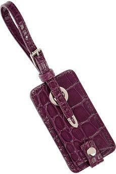With this Jimmy Choo luggage tag in plum croc-effect leather, you may never want to check your bags again!