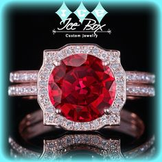 Cultured Pigeon Blood Ruby Engagement Ring 1.25ct Round Pigeon Blood Ruby set in an 14k Rose Gold Diamond Halo Setting