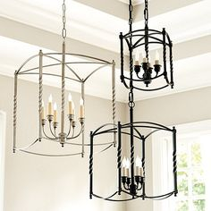 Ideal in an entry or dining area, this large chandelier has a distinctive square cage and twisted post design reminiscent of a late 18th century carriage lamp.