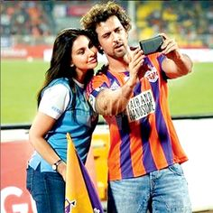 Hrithik Roshan and Lisa Ray clicking a #selfie during an #ISL match in Pune. #Bollywood #Fashion #Style #Beauty #Hot #Handsome