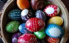 Brightly painted eggs in a basket