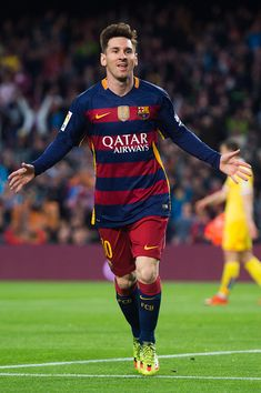 Lionel Messi of FC Barcelona celebrates after scoring the opening goal during the La Liga match between FC Barcelona and Sporting Gijon at Camp Nou...