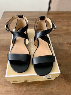 Women's Michael Kors leather Sandals size 8M. Worn twice. A little wear to the bottom of the shoe, but the top is in mint condition. The shipping price includes the box. I can ship without the box for 4.99. Message me prior to purchase and I'll update it. One owner. Comes from smoke free home. I'm willing to combine items to help reduce shipping costs. Like the items you're interested in and message me prior to purchase. Thank you! Leather Sandals, Shoes Sandals, Michael Kors Sandals, My Baby Girl, Ankle Strap, Mint, Smoke Free, Ship, Box