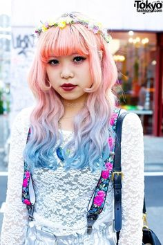 Long curls, straight cut bang with extended edges, dye fade from pink to blue. It's like high contrast bubble gum.