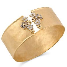 14k Diamond Cuff Bracelet with little flowers from Borsheims. This would also be a beautiful cuff for a bouquet!