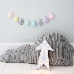 Pastel droplet garland for nursery, Donna Wilson cloud cushion and light up arrow by Gingerrock Designs on Etsy.