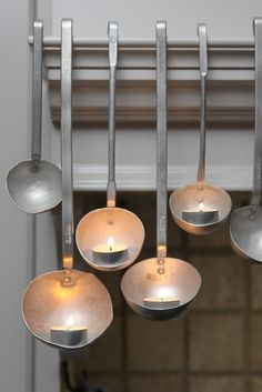 tea lights balanced in soup ladles...lovely lighting...The creativity is fantastic!