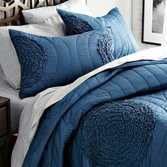 I would like to do gray and a deep blue when we get to redo our room.  Love this midnight blue ruffled quilt from West Elm.