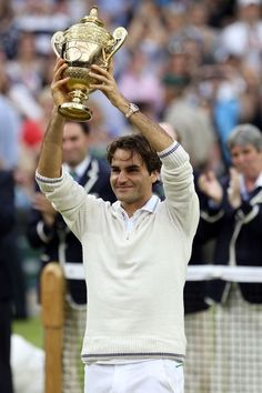 LONDON, ENGLAND - JULY 08: Roger Federer of Switzerland holds up the winner's trophy after winning his Gentlemen's Singles final match against Andy Murray of Great Britain on day thirteen of the Wimbledon Lawn Tennis Championships at the All England Lawn Tennis and Croquet Club on July 8, 2012 in London, England. (Photo by Julian Finney/Getty Images)