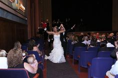 Stacie & Chris  down the aisle at the Campus Theatre