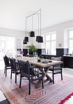 dining room with two-tone walls, bamboo chairs and moroccan rug | the home of Tine Kjeldsen