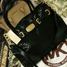 """SOLD gorgeous snake print leather hamilton Michael Kors Hamilton Black Genuine Leather Embossed Python Handbag. New with tag. Shinning and Gorgeous genuine soft leather handbag Size approx. 15"""" w x 10.5"""" h x 5.5"""" d two handles and shoulder strap gold tone hardware. ONLY LOOKING TO TRADE FOR A LOUIS VUITTON BAG IN NEW OR EXCELLENT CONDITION. I can bundle this bag for a trade.  Not looking to sell. This bag, is hard to find and NWT. Please no other trades. Michael Kors Bags"""