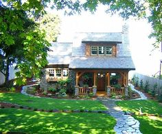 A storybook cottage wants a palette of earthy tones as creams, browns, rusts and other colors that tie the house to the ground. Whether introduced in the landscaping or as accents in the architecture, these colors keep the house from… Continue Reading → Small Cottages, Cabins And Cottages, Country Cottages, Small Cabins, Haus Am See, Cute Cottage, Rustic Cottage, Cute House, Cute Little Houses