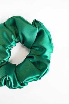 "Emerald Green - Satin Scrunchie  Handmade Item  This listing is for one scrunchie.  Receive a discount when you order 3 Scrunchies! Use the code ""SETOF3"" at checkout.  Every scrunchie is handmade by us in Alberta, Canada. These can be wrapped around your hair once, or multiple times depending on the thickness of your hair. Handmade Accessories, Handmade Items, Bridal Shower Favours, Emerald Green Hair, Green Satin, Birthday Party Favors, Alberta Canada, Scrunchies, Your Hair"