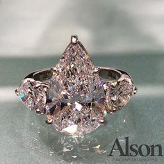 Stunning 5.5 pear-shaped diamond engagement ring flanked by 1.46 carats of pear-shaped diamonds.