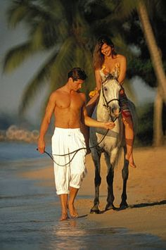 I want a sexy man to teach me how to ride a horse...on a beach. :D