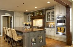 Love this paint color, cabinets, barstools, double ovens, and white trim. Love it all.