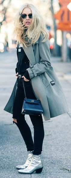 Shea Marie + striking and edgy + black jeans + patent silver ankle boots + stylish teal overcoat + classic retro shades Brands not specified.
