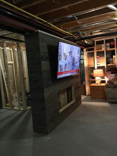 We created barn board and built this wall. The start of our basement Reno