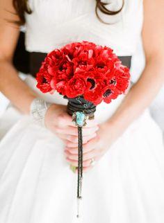 red bouquet #redflowers #winterwedding #redweddingideas http://www.weddingchicks.com/2012/04/05/snowy-winter-wedding-ideas/