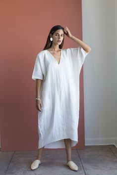 """100% linen. One size fits most. Ivory is in stock and will ship immediately. All other colors are PREORDER ONLY, and will ship in mid-November. Measurements (taken with garment lying flat): chest: 30"""" sleeve opening: 6.5"""" shoulder to front hem: 45"""" shoulder to back hem: 48"""" hem: 24"""""""
