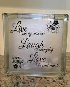 Sue - could be a good Cricut project, maybe substitute another graphic for the flowers - Live Laugh Love Glass Block by LilLexCreations on Etsy Painted Glass Blocks, Decorative Glass Blocks, Lighted Glass Blocks, Glass Cube, Glass Boxes, Vinyl Crafts, Vinyl Projects, Christmas Glass Blocks, Christmas Wood