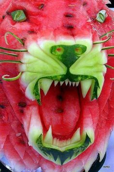 I love the fruit and veg section the best. I like the reds and yellows and greens and the smell of limes. I weigh pieces of fruit and smother them in gladwrap. Ka chunk.  Just look at what you can do with a watermelon!