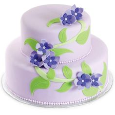 Violets on the Vine Cake - A bouquet of pretty posies winds its way up two fondant-covered tiers. Cut the free-form flowers and leaves using the Cut-N-Spin Rotating Cutting Board — it gives you more control when  cutting those curves!