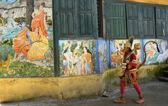 A Hindu sadhu, or holy man, takes a stroll near the Pashupatinath Temple area in the Nepalese capital Kathmandu. The area is home...