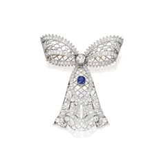 Gold, Platinum, Diamond and Sapphire Brooch -    The openwork bow gathered at the center by an old European-cut diamond weighing approximately .65 carat, accented by a cushion-cut sapphire weighing 1.22 carats, further set with numerous old European-cut diamonds weighing approximately 5.70 carats, numbered 25874; circa 1910.