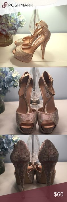 HP! Steve Madden Platform Bling Sandals 7.5 These are a gorgeous pair of pre-owned (only worn 4 times) Steve Madden platform sandals covered completely in aurora borealis mini crystals. They are a size 7.5 and run very true to size. Underneath all the bling, is a very sexy nude color satin fabric. These shoes sometimes WILL look silver though, especially under bright lights (see last pic). The bottoms are in good condition, however the fabric is split on both heels (see last pic) but this is…