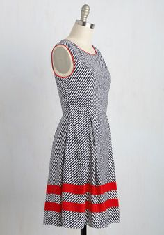 Cocktail parties, business meetings, sophisticated luncheons - this sleeveless dress can handle it all! When it comes to excelling in your complex schedule, the navy and white chevron pattern, bright red piping, and matching hemline stripes of this sleeveless piece all pass with flying colors!