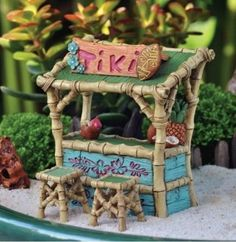 """The rooftop is done in palm leaves and features a sign that says """"Tiki"""". Tiki Bar and Two Stools. Creating a fairy garden is easier than you think! The most important factor in creating a miniature fairy garden is to believe in the magic of fairies. Beach Fairy Garden, Fairies Garden, Fairy Garden Furniture, Decoupage, Gnome Garden, Fairy Gardening, Organic Gardening, Fairy Doors, Fairy Garden Accessories"""