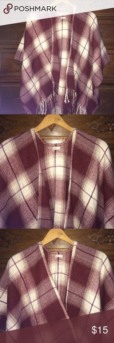 Hollister Plaid Fringed Kimono Sleeve Cape Good used condition. Size XS/S. (I typically wear a medium in Hollister and it fits me perfectly.) 100% Acrylic. Hand wash. Burgundy and cream colors. Kimono style sleeves. Super warm and looks great over jeans. Hollister Jackets & Coats Capes
