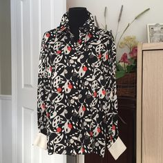 Vintage..Escada by Margaretha Ley 100% silk blouse Designer ...Escada ...Margaretha Ley, made in Germany, 100% silk, colors of black, white, with accents of red, white cuffs, black mother of pearl buttons, see photos, beautiful blouse. Very good condition. No trade, no pp, smoke and pet free environment. Escada Tops Blouses