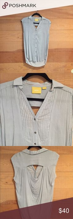 Maeve from Anthropologie srtiped tunic Maeve soft, drapey, tunic with blue/white pinstripe print. Has back cutout and option sash for a more fitted look. Purchased at Anthropologie, size zero but can definitely fit up to size Medium. Anthropologie Tops Blouses