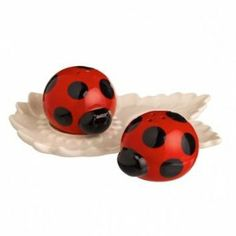 "Grassland Road Out on a Whim - Salt and Pepper Shaker Ladybug on Daisy Tray by Grassland Road. $6.99. Tray 2 3/4"" x 4 1/4"". Ceramic. Shakers: 1 1/4"" x 2"" x 1 1/2"". Cute little salt and pepper shakers in the shape of a ladybugs on a try. One has 3 holes the other has 2 holes."