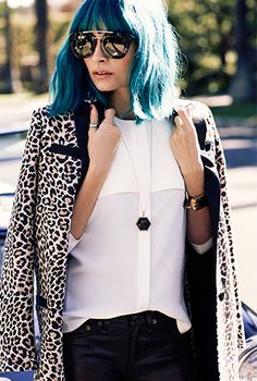 Nicole Richie // Blue hair with bangs, oversized sunglasses, leopard jacket & a white top #style #fashion #celebrity