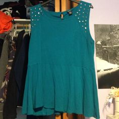 Torrid Size 3 Studded Peplum Top Worn a few times. Super comfortable. Keyhole cutout in the back and studs on the shoulders. torrid Tops Blouses