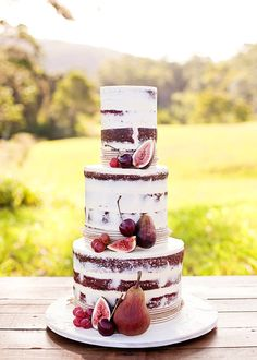 Wedding styling we love! Red velvet wedding cake decorated with fresh fruit including Autumn plums, cherries, grapes and fresh figs. xx www.graceloveslace.com.au