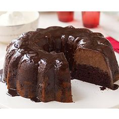 Triple-Chocolate Mousse Cake Recipe Desserts with chocolate syrup, chocolate cake mix, water, oil, eggs, sour cream, cream cheese, soften, sugar, evaporated milk, semisweet chocolate, Cool Whip Whipped Topping