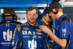 At-track photos: Friday at Martinsville Saturday, April 2, 2016 Dale Earnhardt Jr., driver of the No. 88 Nationwide Chevrolet, talks with crew chief Greg Ives in the garage area during practice for the NASCAR Sprint Cup Series STP 500 at Martinsville Speedway. Photo Credit: Photo by Brian Lawdermilk/Getty Images