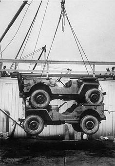 Double-stacked jeeps being loaded on a ship, Hampton Roads Port of Embarkation, 11 June 1943