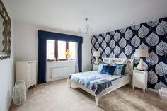 Master bedroom featuring statement leaf design wallpaper
