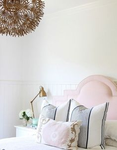 10 Tips for How to Decorate Like a Designer #pink headboard navy pillows