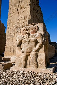 Dendara Temple funny statue carving Egyptian dwarf God Bes standing entrance of the  home of the Goddess Ha...