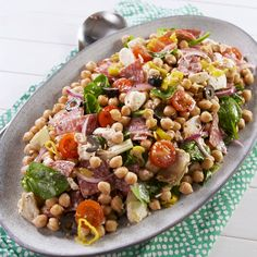 This versatile chickpea salad is a great side dish (hello potlucks!) but can easily be a full meal on its own! If you're making it for meal prep, we'd suggest holding off on adding the spinach until you're ready to eat. Get the recipe at Delish.com. #delish #easy #recipe #chickpea #antipasto #salad #healthy