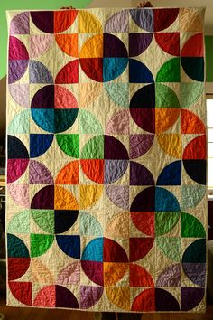 Modern Drunkards Path Quilt... see Running in Circles tutorial I just pinned to figure out how to make this.